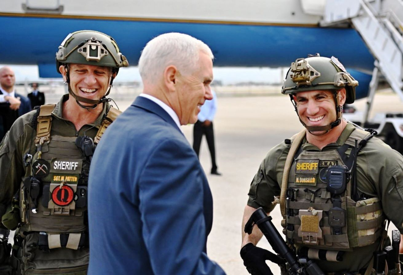 Pence_posing_with_QAnon_police_crop